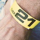 Yellow wristband on wrist: Over 21